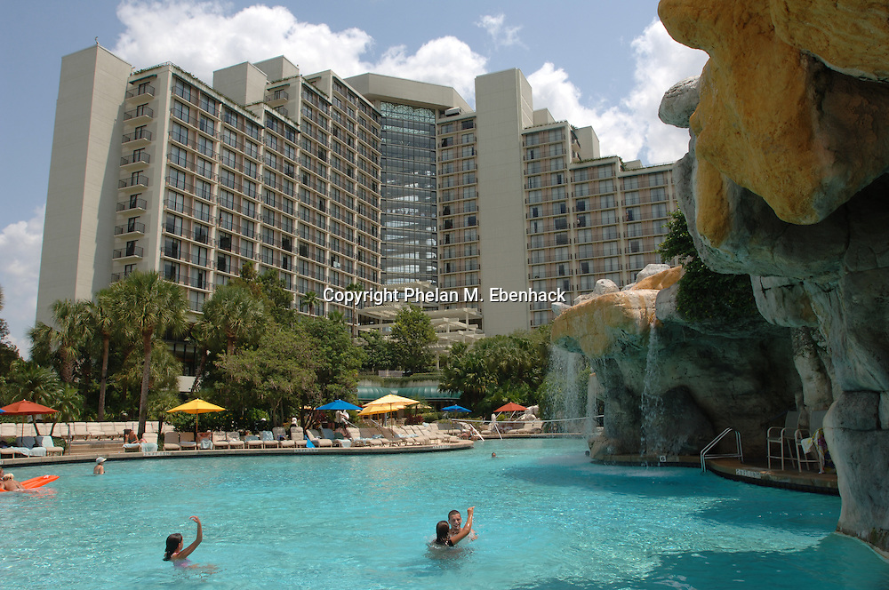 Swimmers relax in the massive pool outside the Hyatt Grand Cypress Resort in Orlando, Florida.