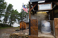 Jacobsen Salt Company in Netarts, Oregon, USA. The salt is harvested from sea water pumped from Netarts Bay in to their facility located on the shore of the bay. Jacobsen Salt was founded in 2011 by owner Ben Jacobsen.  Their main products are flake and kosher sea salts available for sale in their store in Portland, Oregon.  Contact Ben Jacobson sales@jacobsensalt.com or 503-473-3952. Pictured here is the pump house (on the left) and the boil pots with Netarts Bay in the background.