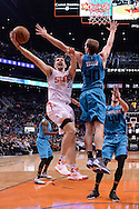 Jan 6, 2016; Phoenix, AZ, USA; Phoenix Suns forward Mirza Teletovic (35) drives the ball against Charlotte Hornets center Cody Zeller (40) at Talking Stick Resort Arena. The Phoenix Suns defeated the Charlotte Hornets 111-102. Mandatory Credit: Jennifer Stewart-USA TODAY Sports
