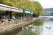 Greece, Macedonia, Castoria; Fishing Boats and swans on Lake Orestiada