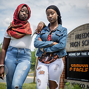 WOODBRIDGE,VA-JUN8: Best friends Fatmata Mansaray (right) and Hajah Bah, outside Freedom High School, in Woodbridge, Virginia, June 8, 2017. Fatmata said she has been harassed by administrators every time she wore a hijab and eventually had to obtain a note from an assistant principal that she could show to officials who told her to remove the head covering. Hajah began wearing a hijab last week for Ramadan, leading to a confrontation with an administrator who threatened to write her up when she refused to remove it and protested. School administrators have since apologized to both young women and their families. (Photo by Evelyn Hockstein/For The Washington Post)