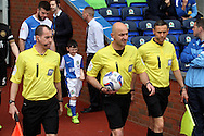 Referee Roger East and his assistants Peter Bankes and Mark Scholes lead the teams out. Skybet football league championship match, Blackburn Rovers v Wigan Athletic at Ewood Park in Blackburn, England on Saturday 3rd May 2014.pic by Chris Stading, Andrew Orchard sports photography.