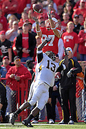 University of Nebraska wide receiver Nate Swift (87) pulls in a 56-yard pass from Zac Taylor, over Missouri defensive back Cornelius Brown (13) in the fourth quarter at Memorial Stadium in Lincoln, Nebraska, November 4, 2006.  The Huskers beat the Tigers 34-20.<br />