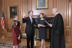 October 6, 2018 - Washington, District of Columbia, U.S. - In this photo released by the Supreme Court, former Associate Justice of the Supreme Court Anthony M. Kennedy administers the Judicial Oath to Judge Brett M. Kavanaugh in the Justice's Conference Room, Supreme Court Building. Mrs. Ashley Kavanaugh holds the Bible..Mandatory Credit: Fred Schilling, Collection of the Supreme Court of the United States via CNP (Credit Image: © Fred Schilling/CNP via ZUMA Wire)