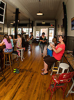 Svea Mellor, Madeline Butler, Elsa-Anne Mellor , Melissa Mellor and Jacob and Carrie Butler enjoy coffee and waffles at Wayfarer Coffee Roasters on Thursday afternoon.  (Karen Bobotas/for the Laconia Daily Sun)