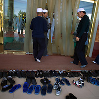 Chinese muslims get ready for one of the daily prays outside of the  Dujia Tan Mosque in northwest China's Ningxia Hui Autonomous Region, China, on Thursday, September. 11, 2008. The islam is the second biggest religion in China, where there are between 20 and 30 millions of muslims.