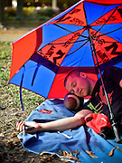 30164396A OXFORD, Miss. - Friday October 3, 2014 - Patrick Myers, 18, a freshman from Washington, D.C., rests on the lawn of the grove using a football as a pillow while saving a spot for about forty friends the day before the home game between Ole Miss and Alabama.  <br /> <br /> William DeShazer for the New York Times