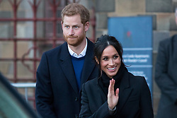 © Licensed to London News Pictures. 18/01/2018. Cardiff, UK. Meghan Markle and Prince Harry leave Cardiff Castle, after visiting the Wales Culture Fair. Photo credit : Tom Nicholson/LNP