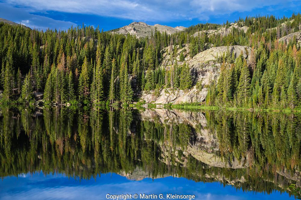 Shoreline reflections in Bear Lake, Rocky Mountain National Park, Colorado.