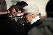 Karl Lagerfeld with crew during a photo shoot on Fulton Landing, Brooklyn, NY. March 24, 2008