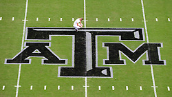 "Texas A&M Yell Leader Steven Lanz prays at midfield above the new Texas A&M ""Blackout"" logo before the start of the South Carolina vs. Texas A&M NCAA college football game on Saturday, Oct. 31, 2015 at Kyle Field in College Station, Texas.  (AP Photo/Sam Craft, The Bryan-College Station Eagle)"