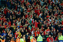 CARDIFF, WALES - Tuesday, October 13, 2015: Wales supporters celebrate after qualifying for the finals following a 2-0 victory over Andorra during the UEFA Euro 2016 qualifying Group B match at the Cardiff City Stadium. (Pic by Paul Currie/Propaganda)