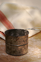 Old flour sifter, Kitchen towel on the back