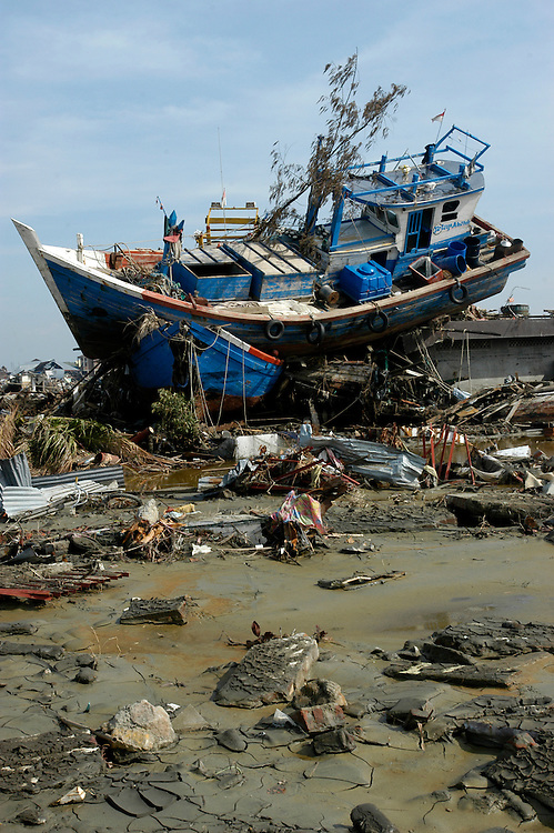 A fishing boat is violently deposited inland by the Tsunami that devastated Banda Aceh.