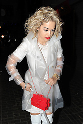 Rita Ora wearing see-through rain coat, white dress, thigh high boots attends Fran Cutler's 50th birthday party at The Box Club in London, UK. 01/05/2013<br />