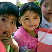 Children from the village of Neque welcome the CARE Learning Tours Group to their village. CARE is helping support community activities in Neque...Microfinance programs use a proven community based group savings and loans methodology as an entry point to mobilize group members to address a wide range of constraints to the social and economic empowerment of marginalized women and girls. ..Women in the community have said that when they first joined the group their husbands didn't take much notice. Now they are working with their husbands to discuss loans and business plans and ways to help their families. The group meets monthly and provides support to each other both financially and by sharing their experiences with their individual businesses. ..Increasing access to financial services for the poor must be part of an integrated and holistic approach to community empowerment in order to effectively address maternal health. Such an approach acknowledges the deep inequities that shape health seeking behaviors and would marry supply and demand by strengthening health systems and service delivery on the one hand while building community pressure for quality care on the other. ..