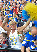 Warrington Wolves fans celebrate during the Ladbrokes Challenge Cup Semi-Final  match Warrington Wolves -V- Wakefield Trinity Wildcats at , Leigh, Greater Manchester, England on Saturday, July 30, 2016. (Steve Flynn/Image of Sport)