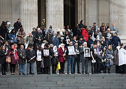 © Licensed to London News Pictures. 14/12/2017. London, UK. Friends and relatives of the victims of the Grenfell fire stand outside St Paul's Cathedral after attending the Grenfell Tower National Memorial Service mark the six month anniversary of the fire. The service was attended by survivors and relatives of those who lost their lives in the fire, as well as members of the emergency services and members of the Royal family. 71 people were killed when a huge fire ripped though 24-storey Grenfell Tower block in west London in June 2017. Photo credit: Peter Macdiarmid/LNP