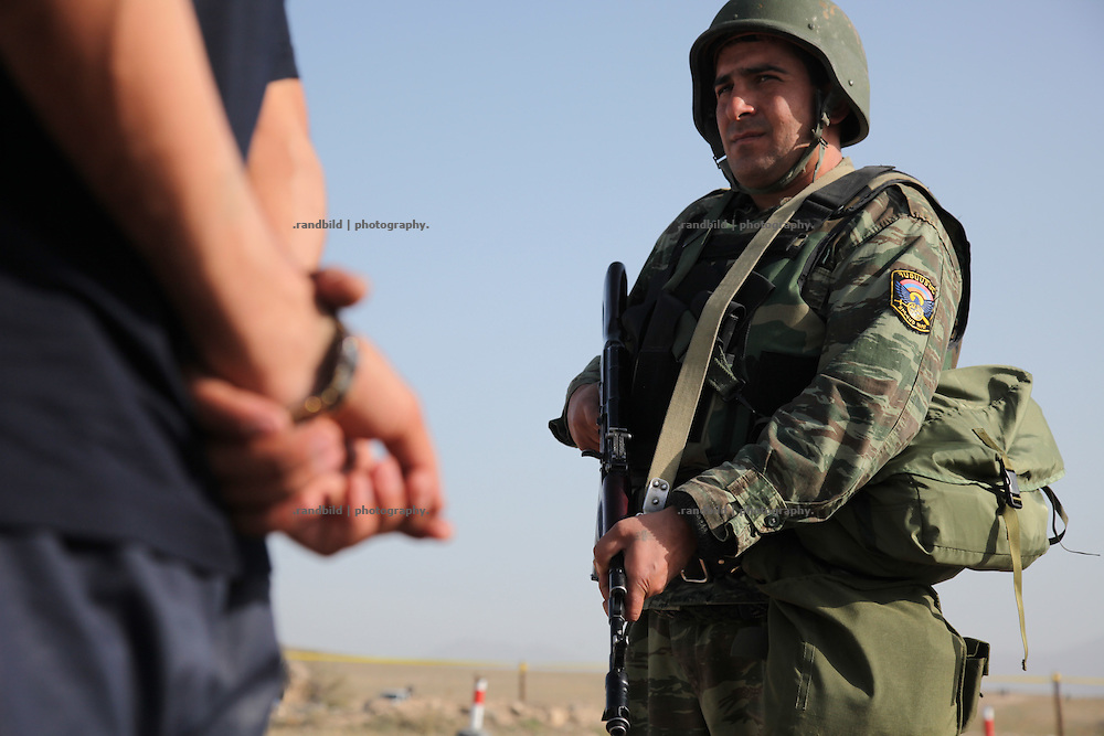 An armenian battlegroup getting an exercise to become trained for possible NATO peacekeeping missions abroad at a training area near armenian capital Yerevan. They exerciceing fightings and orderly checkpoint behavior. Picture: Soldiers guarding a checkpoint and search and controll people.