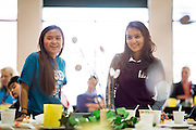 Clowie Ravanera, 13, and Natalie Lata, 13, (right) of Rancho challenge Russell students and faculty to fundraise more canned goods and money during the Jack Emery Food Drive luncheon at Milpitas Community Center in Milpitas, California, on November 4, 2014. (Stan Olszewski/SOSKIphoto)
