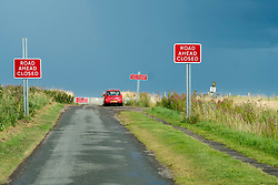 Red Road Ahead Closed warning signs approaching the cliff tops of the Yorkshire Coast East England<br />  4 August 2016<br />  Copyright Paul David Drabble<br />  www.pauldaviddrabble.photoshelter.com