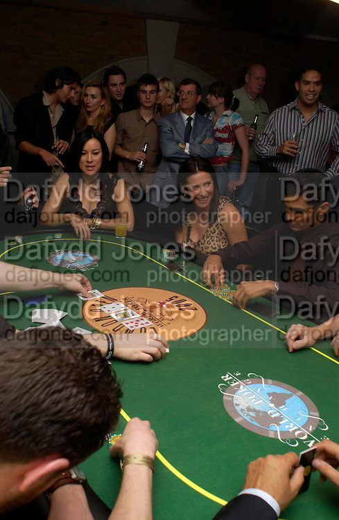 Jennifer Tilley and Mimi Rogers. Opening Night Party of the first  cards tournament hosted by online poker website World Poker Exchang. Old Billingsgate Market, London. 3 August 2005. ONE TIME USE ONLY - DO NOT ARCHIVE  © Copyright Photograph by Dafydd Jones 66 Stockwell Park Rd. London SW9 0DA Tel 020 7733 0108 www.dafjones.com