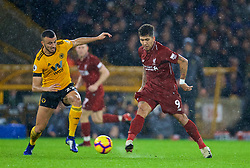 WOLVERHAMPTON, ENGLAND - Friday, December 21, 2018: Liverpool's Roberto Firmino (R) and Wolverhampton Wanderers' Romain Saïss during the FA Premier League match between Wolverhampton Wanderers FC and Liverpool FC at Molineux Stadium. (Pic by David Rawcliffe/Propaganda)