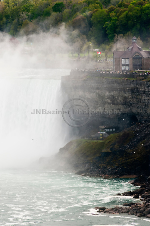 Horseshoe Falls begets tourist attractions such as Behind the Falls pictured here below the falls on the Canadian side.