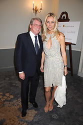CARL HIRSCHMAN and SABINA McTAGGART at a dinner hosted by the Fortune Forum at The Dorchester, Park Lane, London W1 on 2nd July 2008.<br />