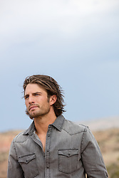 handsome rugged man with long hair outdoors