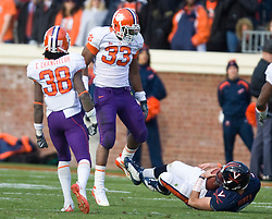 Clemson linebacker Kavell Conner (33) reacts after sacking Virginia quarterback Marc Verica (6) in the second half.  The Clemson Tigers defeated Virginia Cavaliers 13-3 in NCAA Division 1 football at Scott Stadium on the Grounds of the University of Virginia in Charlottesville, VA on November 22, 2008.