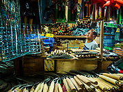 06 AUGUST 2017 - MENGWI, BALI, INDONESIA: A tool vender in the Bringkit Market in Mengwi, about 30 minutes from Denpasar. Bringkit Market is famous on Bali for its Sunday livestock and poultry market. Hundreds of the small Bali cows are bought and sold there every week. Bali's local markets are open on an every three day rotating schedule because venders travel from town to town. Before modern refrigeration and convenience stores became common place on Bali, markets were thriving community gatherings. Fewer people shop at markets now as more and more consumers go to convenience stores and more families have refrigerators.     PHOTO BY JACK KURTZ