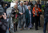 National News and Pictures<br /> Date: 13/05/14<br /> PH:  Nick Edwards<br /> Pictured: Rolf Harris, his wife Alwen Hughes (2nd from right) and his Daughter Bindi (far left)<br /> Caption: Rolf Harris aged 84 outside Southwark Crown Court in Central London today, where he is due to stand trial on 12 counts of indecent assault. The Entertainer was accompanied by his wife Alwen Hughes and a security team