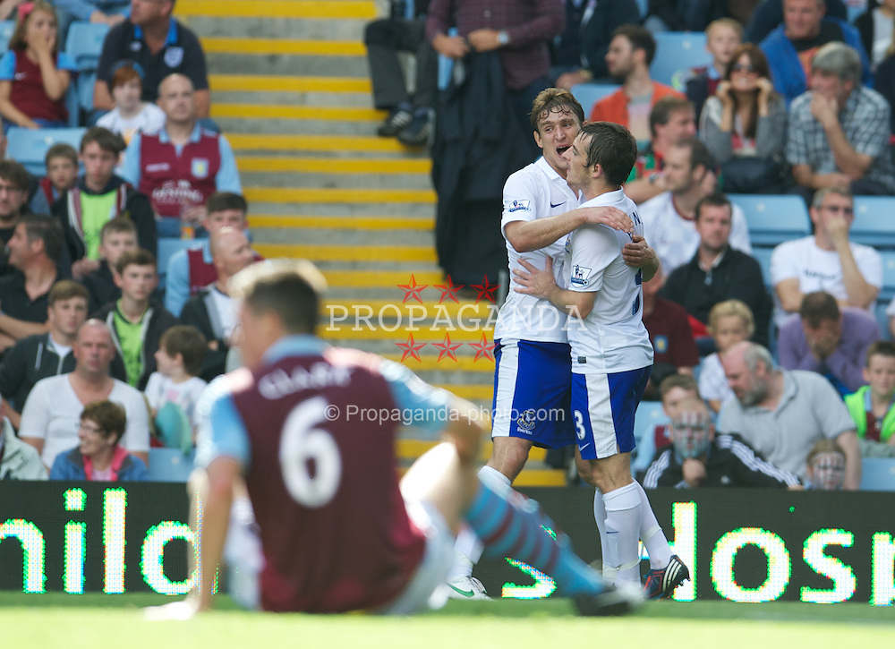 BIRMINGHAM, ENGLAND - Saturday, August 25, 2012: Everton's Nikica Jelavic celebrates scoring the third goal with team-mate Leighton Baines against Aston Villa during the Premiership match at Villa Park. (Pic by David Rawcliffe/Propaganda)