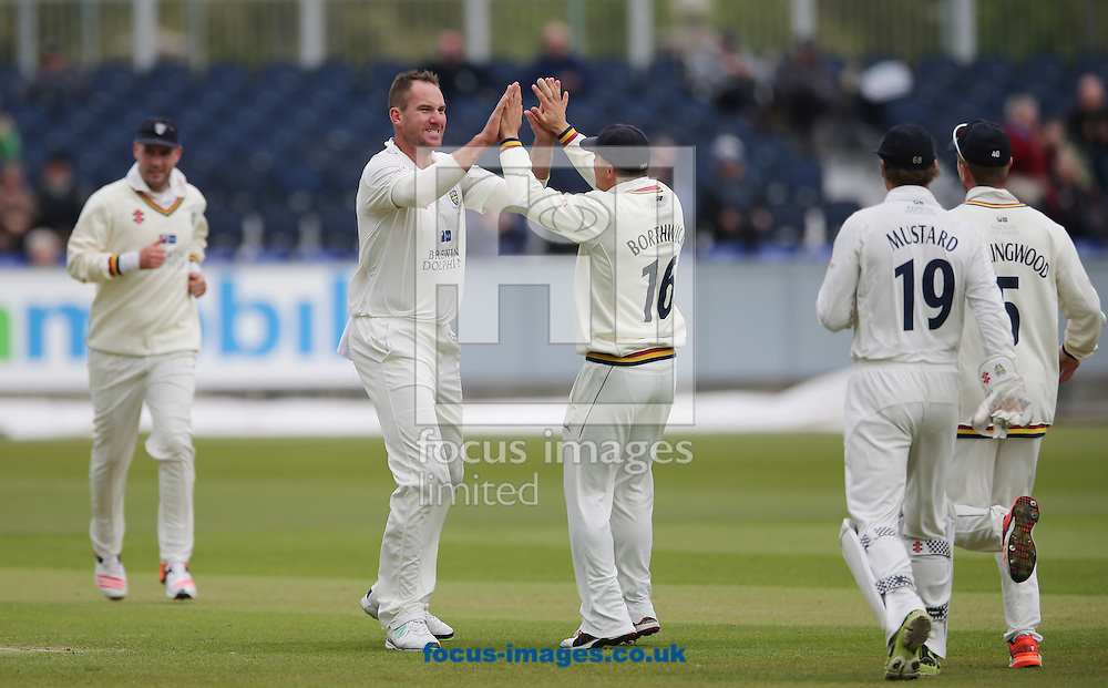 John Hastings (2nd left) of Durham is congratulated by Scott Borthwick (c) on the wicket of James Taylor (not shown) of Nottinghamshire during the LV County Championship Div One match at Emirates Durham ICG, Chester-le-Street<br /> Picture by Simon Moore/Focus Images Ltd 07807 671782<br /> 10/05/2015