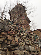 WEIFANG, CHINA - FEBRUARY 12: (CHINA OUT)<br /> <br /> Self-made Seven-storey House made from stones, wood and earth,<br /> <br /> General view of a self-made seven-storey house on February 12, 2016 in Weifang, Shandong Province of China. A farmer with mental deficiency spent more than ten years collecting stones, wood and earth, and building the house by himself. <br /> ©Exclusivepix Media