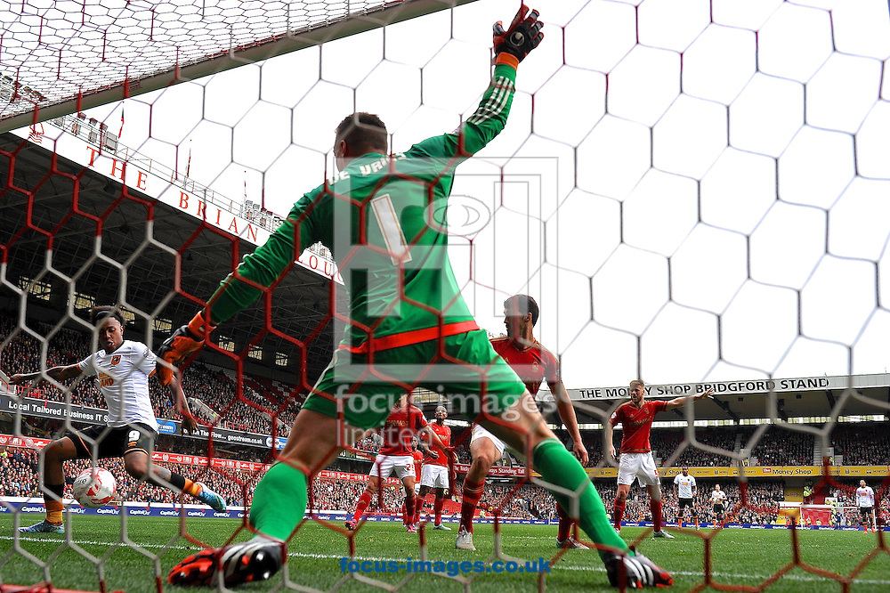 Abel Hern&aacute;ndez of Hull City (left) scores their first goal to make it Nottingham Forest 0 Hull City 1 during the Sky Bet Championship match at the City Ground, Nottingham<br /> Picture by Ian Wadkins/Focus Images Ltd +44 7877 568959<br /> 03/10/2015