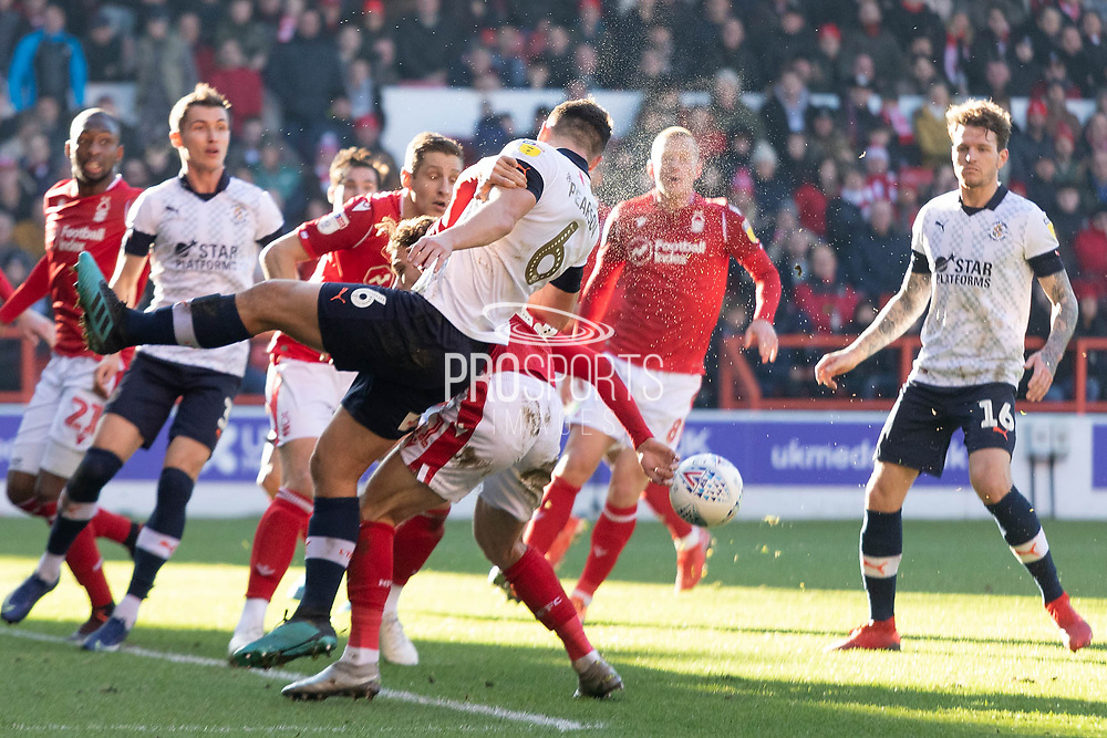 Matthew Pearson (6) clears during the EFL Sky Bet Championship match between Nottingham Forest and Luton Town at the City Ground, Nottingham, England on 19 January 2020.