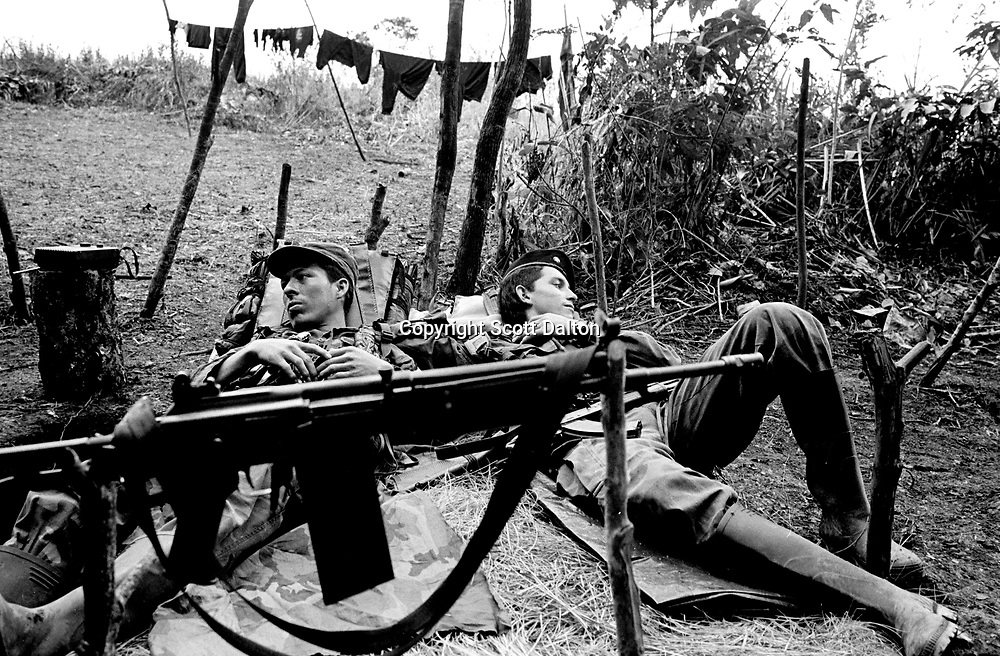 Guerrillas of the Revolutionary Armed Forces of Colombia, FARC, rest in their camp near La Macarena, a zone with a heavy rebel presence in southern Colombia. (Photo/Scott Dalton)