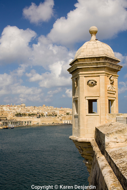 A vedette (watchtower) at Senglea looks over the Grand Harbour of Valletta, Malta. The watchtower is decorated with carvings of eyes and ears symbolizing watchfulness. The little vedette at the tip of the Senglea peninsula is one of the classic sights of Malta.