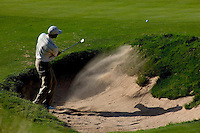 Tiger Woods chips out of a sand trap of hole nine of day one of practices at the PGA championship at Whistling Straits Monday Aug. 9, 2004 Sheboygan Wi.     Photo Darren Hauck.......................