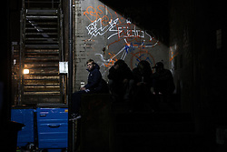 © Licensed to London News Pictures . 27/12/2015 . Wigan , UK . Four youths sit down a side alley . Revellers in Wigan enjoy Boxing Day drinks and clubbing in Wigan Wallgate . In recent years a tradition has been established in which put on fancy dress for a Boxing Day night out . Photo credit : Joel Goodman/LNP