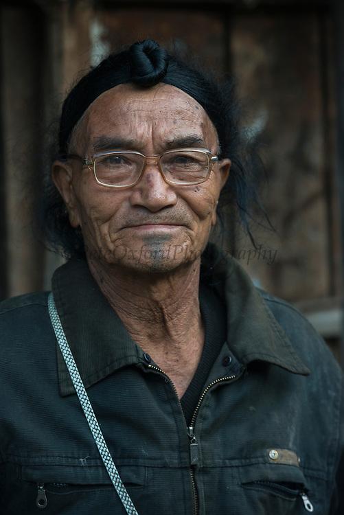 Apatani man showing hair knot.<br /> Apatani Tribe<br /> Ziro Valley, Lower Subansiri District, Arunachal Pradesh<br /> North East India
