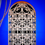 Ornate window decoration at Jardin Majorelle in Marrakech. This former home to French painter Jacques Majorelle is now owned by fashion designer Yves Saint Laurent and contains the Museum of Islamic Art.