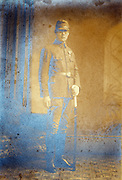 vintage studio portrait of person with samurai sword wearing military uniform with medal decoration Japan 1930s