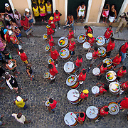 Students of the Olodum School, an arts and music school set up for underprivelaged children by the renown Brazillian music group Olodum, play outside the classroom in the streets of the Pelourinho neighborhood of Salvador, Brazil. Photo by Jen Klewitz