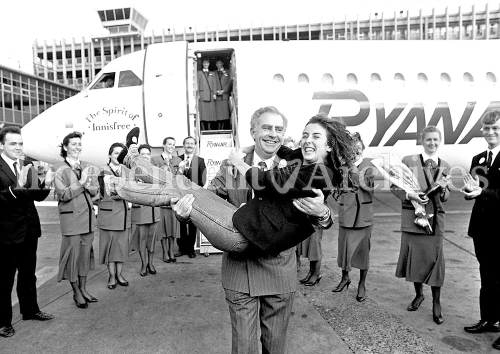 Ryanair's one millionth passenger Jane O'Keeffe from Granville Ave Cabinteely in the arms P.J.Goldrick 20 October 1988. (Part of the Independent Newspapers Ireland/NLI Collection)