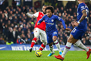 Chelsea midfielder Willian (10) goes past Arsenal forward Alexandre Lacazette (9) during the Premier League match between Chelsea and Arsenal at Stamford Bridge, London, England on 21 January 2020.