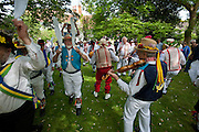 The Thaxted Morris Weekend, Thaxted and surrounding villages, Thaxted, Essex, England. 30 May 2015<br /> Seen here The Thaxted Morris in Red and white Stripes perform outside the 14th cent. ancient Guildhall in the centre of Thaxted.<br /> 21 teams or 'sides' of Morris Men including teams from Holland , Denmak and Australia danced through the villages such as Finchingfield in rural north Essex during the start of the 345th meeting of the member clubs of the Morris Ring and the 82nd meeting hosted by the Thaxted Morris Men.