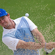 August 23, 2014: Rory McIlroy (NIR) sprays sand as he hits out of a bunker on the 13th hole during the third round of The Barclays Fed Ex  Championship at Ridgewood Country Club in Paramus, NJ. Mandatory Credit:  Kostas Lymperopoulos/csm  (Credit Image: © Kostas Lymperopoulos/Cal Sport Media)